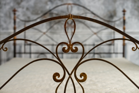 bedstead: back double bed forged of rod,  close up, horizontal photo Stock Photo