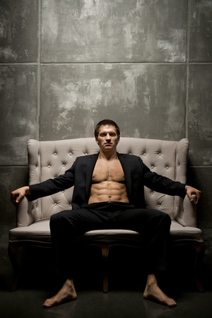 the very muscular handsome sexy guy in black  suit indoor Stock Photo - 18878908