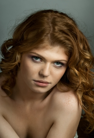 the very  pretty red-haired young woman,  sensual  captivating look ,vertical portrait photo