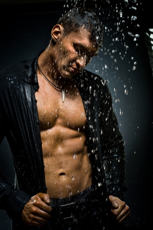 downpour: the very muscular handsome sexy guy under shower