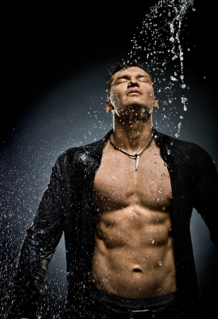muscularity: the very muscular handsome sexy guy under shower