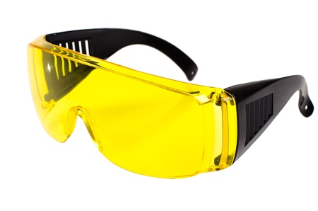 protective spectacles: photo  yellow protective spectacles on white background isolated, close up full face Stock Photo