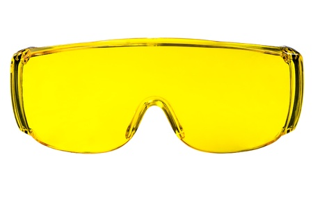 protecting spectacles: photo  yellow protective spectacles on white background isolated, close up full face Stock Photo