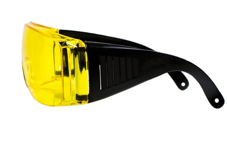 eye protectors: photo  yellow protective spectacles on white background isolated, close up full face Stock Photo