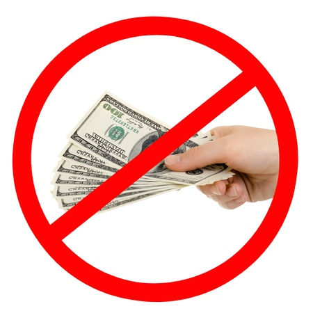 inhibitory: cash  currency note dollar in hand,  prohibiting sign, isolated