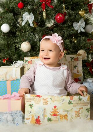 one year old little girl solemnize christmas sit under christmas tree with - What To Get 6 Year Old Little Girl For Christmas