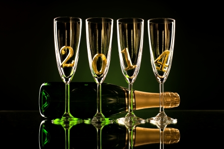 bottle  champagne with four glass goblet and  numeral 2014,  beautiful celebrations  New Year concept photo Stock Photo - 22957286