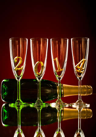 bottle  champagne with four glass goblet and  numeral 2014,  beautiful celebrations  New Year concept photo Stock Photo - 22957287