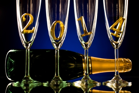 bottle  champagne with four glass goblet and  numeral 2014,  beautiful celebrations  New Year concept photo Stock Photo - 22957290