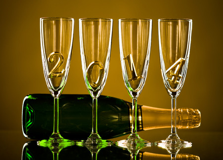 bottle  champagne with four glass goblet and  numeral 2014,  beautiful celebrations  New Year concept photo Stock Photo - 22960773