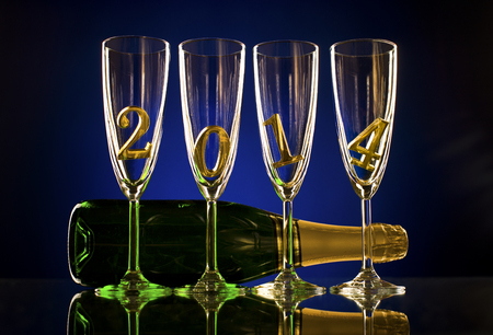 bottle  champagne with four glass goblet and  numeral 2014,  beautiful celebrations  New Year concept photo Stock Photo - 22960837