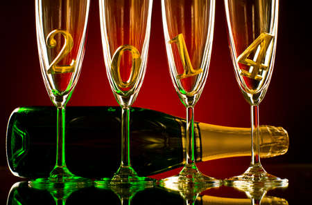 bottle  champagne with four glass goblet and  numeral 2014,  beautiful celebrations  New Year concept photo Stock Photo - 22960838