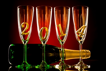 bottle  champagne with four glass goblet and  numeral 2014,  beautiful celebrations  New Year concept photo Stock Photo - 22960853