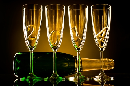 bottle  champagne with four glass goblet and  numeral 2014,  beautiful celebrations  New Year concept photo