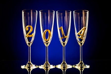 four glass goblet for champagne with  numeral 2014,  beautiful celebrations  New Year concept photo photo