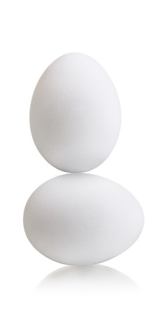 steadiness: two white egg on white background, isolated,  concept  balance