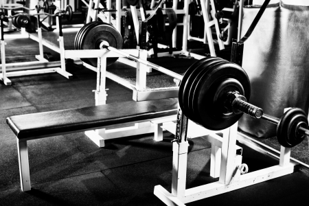 weight room: weight in dark weight room, black-and-white horizontal photo