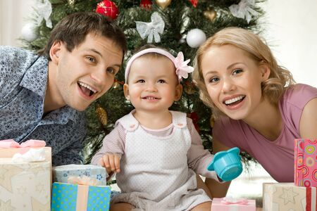portrait very happy family in home with Christmas-tree and gift, smile Stock Photo - 23758433