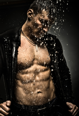 man shower: the very muscular handsome sexy guy under shower