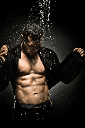 musculation: the very muscular handsome sexy guy under shower