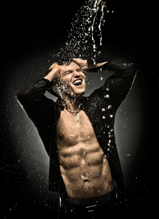the very muscular handsome sexy guy under shower