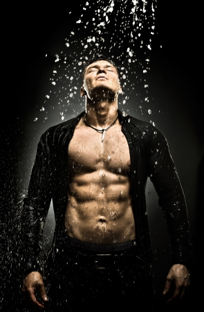 athletic: the very muscular handsome sexy guy under shower