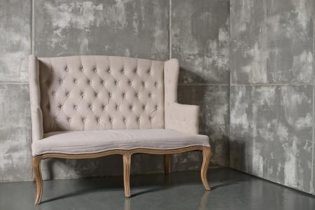 one soft chair on dark grey background,  horizontal photo Stock Photo - 24829639