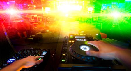 disc jockey: disc jockey with sound control desk Stock Photo