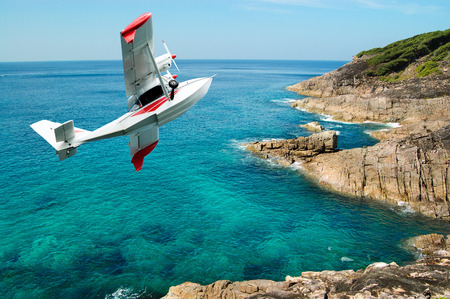 hydroplane flying over beauty rock-beach Indian Ocean in Thailand, concept excursion on airplane