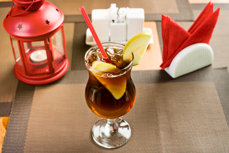 soft drinks: apple freshener soft drinks - punch with ice, on table in restaurant Stock Photo