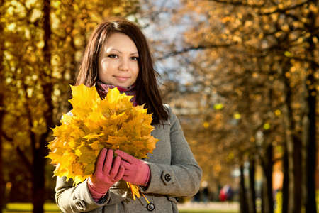 The  young beautiful girl, horizontal portrait,  outdoor in park, autumnal day photo