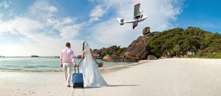 southern thailand: happy newly married couple  in honeymoon, on sun sandy beach in Thailand Stock Photo