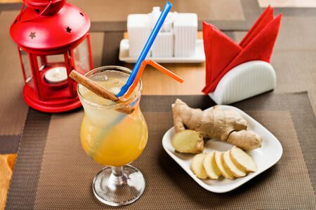 soft drinks: ginger freshener soft drinks - punch with cinnamon, on table in restaurant Stock Photo