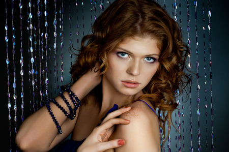 the very  pretty red-haired young woman,  sensual  captivating look , horizontal portrait photo