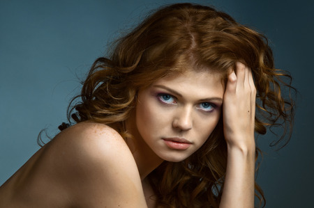 the very  pretty red-haired young woman,  sensual  captivating look, horizontal portrait photo