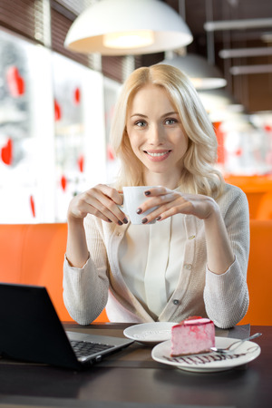 inet: Very beautiful, happy,  young woman, sit in  Cafe  with notebook, vertical portrait