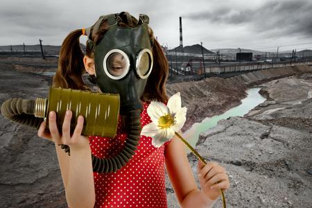 defilement: little girl  in gas mask, smell big white flower