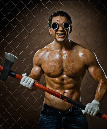 angriness: crazy frenzied chopper  butcher man covered with blood,  action with big axe  Stock Photo