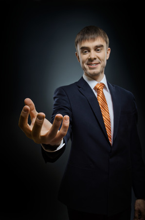 affability: businessman hold  reach out hand , on dark blue background,  business concept