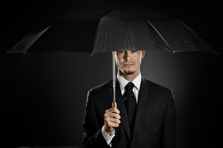 undercover agent: portrait  man the  beautiful  man in blue costume with umbrella,  special-service agent  Stock Photo
