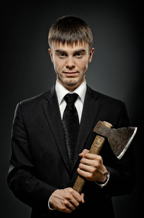 miscreant: portrait  man in black costume and black necktie with axe, sinister look