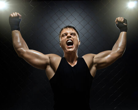 bawl: photo  muscular young  guy street-fighter,  triumphant cries  yell , hard light