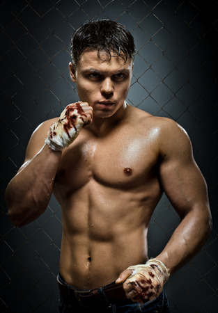 vertical photo  muscular young  guy street-fighter,  aggression look, hard light photo