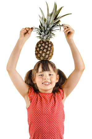 citrous: beauty little girl, hold two pineapple , on white background, isolated
