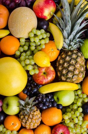 citrous: still life of big  heap multi-coloured fruits,  background