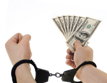 stealer: hand in shackle hold  currency note dollars, on white background, isolated Stock Photo