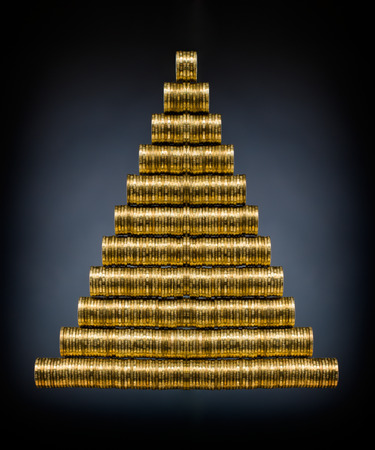 christmas profits: still life of very many rouleau gold  monetary or change coin, on dark blue  background