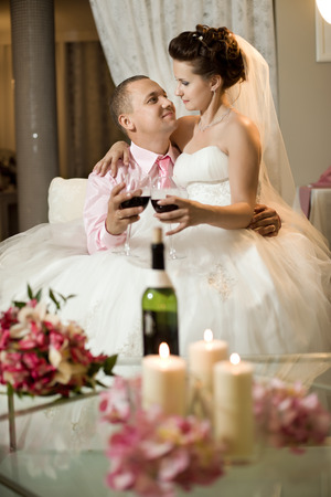 newly married couple in hotel room,  romance wedding dinner photo