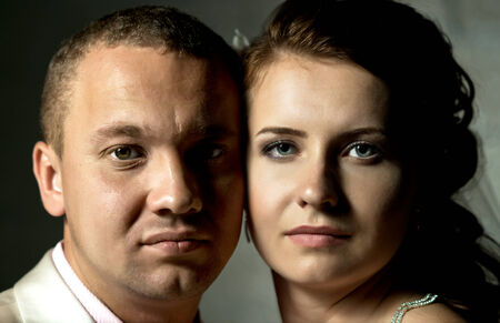 horizontal closeup portrait face couple ,  in studio photo