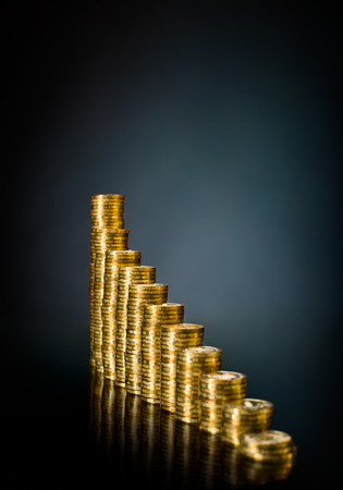 rouleau: very many rouleau gold  monetary or change coin, on dark blue background Stock Photo